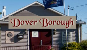 "Picture of the Dover Borough building with red, cursive text over top of the building, ""Dover Borough"""